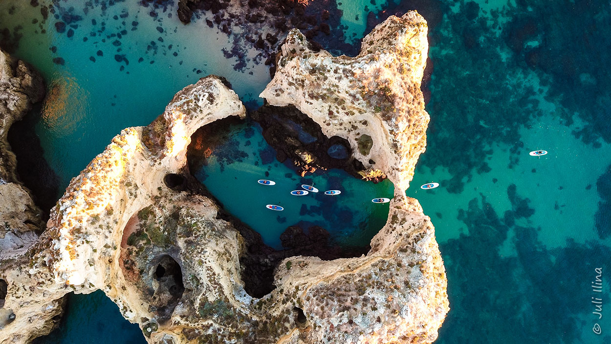 Benagil caves, grottoes and cliffs in Lagos by stand-up-paddle boards, Algarve Portugal